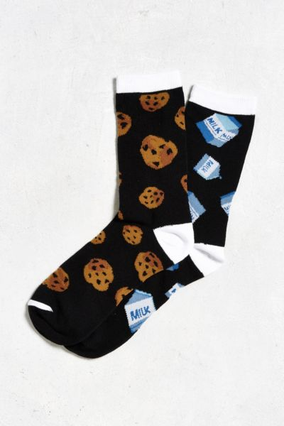 pair of socks with a cookie and milk carton pattern