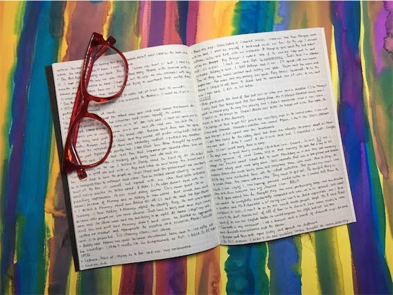 open journal with pages full of words